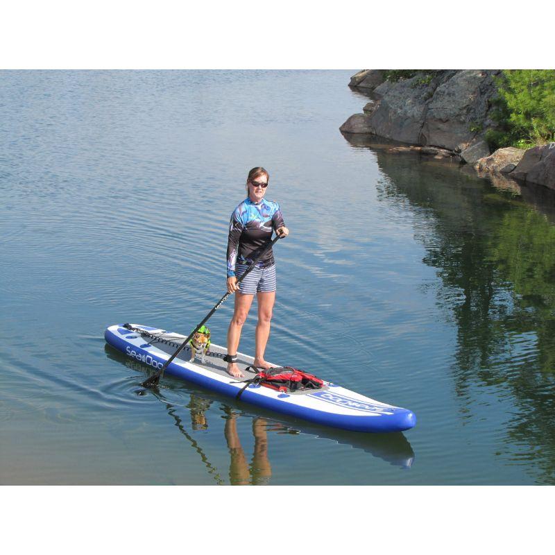 woman and tiny dog on seadog paddleboard