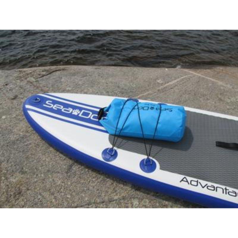 waterproof duffle bag secured by bungee cord on SUP