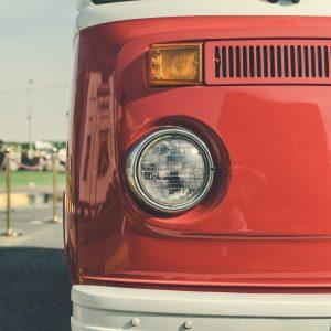 font passenger side of an old orange and white vw van
